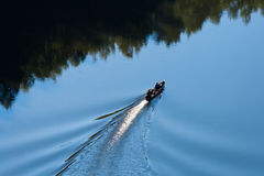 Boat sailing on a river Royalty Free Stock Photo