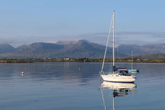 A boat in Roundstone, co. Galway, Ireland. A boat sailing in Roundstone on a good weather day stock image
