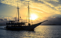 Boat sailing at sunset Stock Image
