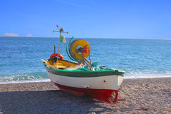 Boat sailing into the sea. A fishing boat is sailing into the sea Royalty Free Stock Image