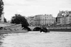 Boat sailing on the Seine river in Paris, black and white Royalty Free Stock Images