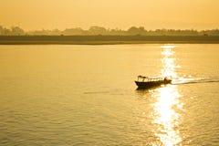 Boat sailing when sunrise Stock Photography