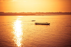 Boat sailing when sunrise Royalty Free Stock Photo