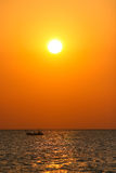 Boat sailing at sunset Royalty Free Stock Photos
