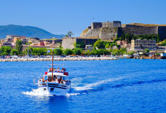 Boat sailing with tourists in daily trips around Corfu island Royalty Free Stock Photography