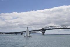 Boat sailing towards Auckland Harbour Bridge, New Zealand Stock Photography