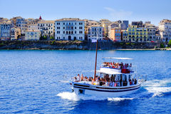 Boat sailing in daily trips around Corfu island Stock Images