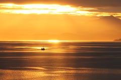 Sailing under Sunshine. Boat sailing under golden sunshine Stock Photo