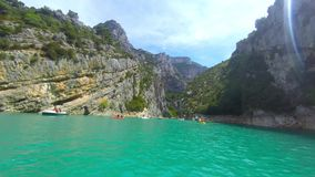 Boat sailing the Verdon river between the limestone mass stock video