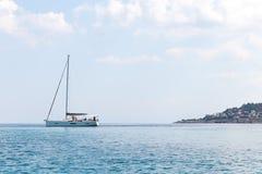 Boat sailinig in an Italian port royalty free stock photography