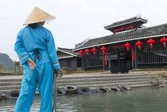 Boat sailor on Li river boat trip, China. Boat sailor in traditional clothes on Li river boat trip, China stock image
