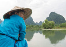 Boat sailor on Li river boat trip, China Royalty Free Stock Image