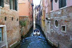 The boat sails on the channel in Venice Stock Photography