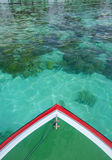 Boat sails with crystal clear water Royalty Free Stock Image