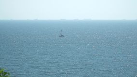 Boat sails floating in the sea. stock video footage