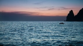 Boat sails on the sea at dusk stock video footage