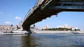 Boat sails under the bridge in Moscow city. Shooting Moscow streets, life, and people canon 5D mark ii at summer 2014 stock footage