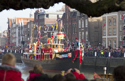 Boat of Saint Nicolas arrives in the harbor stock images