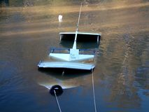 Sunken cruise boat in a river. For sale sign on a sunken cruise boat in a river Stock Photos