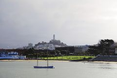 Boat in San Francisco Maritime park. View of little boat on background of San Francisco Maritime park and Coit tower Royalty Free Stock Photos
