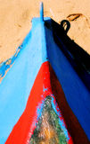 Boat on the sand in Puerto Rico. An old wooden boat on the beach in puerto rico Royalty Free Stock Images