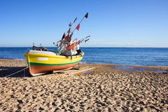 Boat on a Sandy Beach. Single boat on a sandy beach at the Baltic Sea in Poland royalty free stock photography