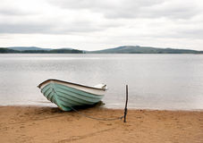 Boat on sandy beach Stock Image