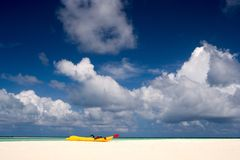 A boat on the sandy beach of  Maldives Stock Images
