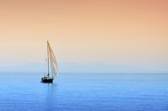 Boat On The Sea. Boat is sailing on the sea in the sunset Royalty Free Stock Images