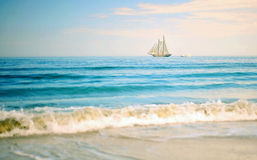 Boat in the sea. A boat and a yacht in a blue sea Stock Photos