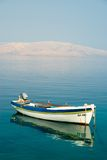 Boat and the sea. Photo of the boat with hills at the back Stock Photos