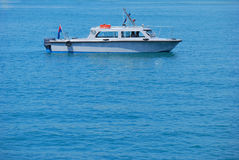 Boat At Sea. A photo taken on a boat afloat at a calm blue sea Stock Photography