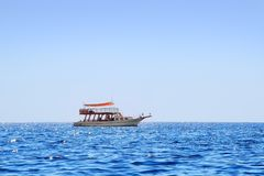 Boat in the sea. Lonely boat is floating in the sea at summer Royalty Free Stock Photos