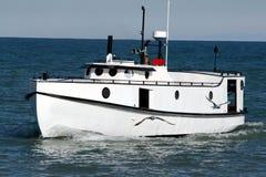 Boat at sea. White lifeboat out at sea Stock Image