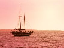 Boat on the sea. Sailing in the evening Stock Image