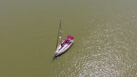 The boat is at sea. Aerial video. A boat stands at sea on a sunny summer day. Aerial video stock video footage