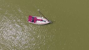 The boat is at sea. Aerial video. A boat stands at sea on a sunny summer day. Aerial video stock video