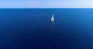 Boat at sea in aerial view. In mediterranean Stock Image
