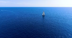 Boat at sea in aerial view. In mediterranean Stock Photo