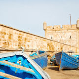 boat and sea in africa  morocco old castle brown brick  sky Stock Image