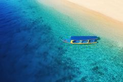 Boat at the sea in Bali, Indonesia. Aerial view of floating boat on transparent turquoise water at sunny day. Top view from drone. Seascape with motorboat in stock photos