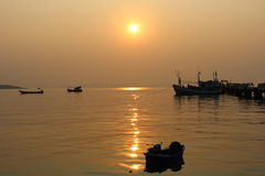 Boat on sea. With the beautiful sunset Royalty Free Stock Photography