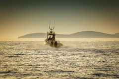 Boat and the sea. Capture the moment at sea .The boat accelerates toward the next destination Royalty Free Stock Photo