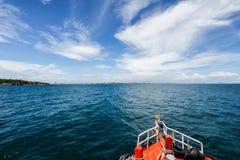 Boat sea and city Stock Photo