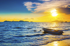 Boat on a sea coast at sunset Royalty Free Stock Images