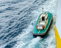 Boat in the sea. The boat floats on the sea Royalty Free Stock Photos