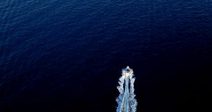 Boat at sea leaving a wake. In mediterranean Stock Photos