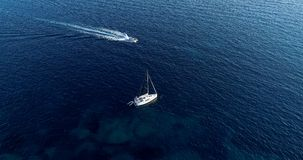 Boat at sea leaving a wake. In mediterranean Stock Photography
