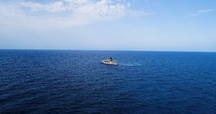 Boat at sea leaving a wake. In mediterranean Royalty Free Stock Photo