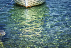 Boat and sea. Moment caught in lens..sea and boat in the background, in the game of colors, green sea and beautiful reflections of the sun in the sea Royalty Free Stock Photos